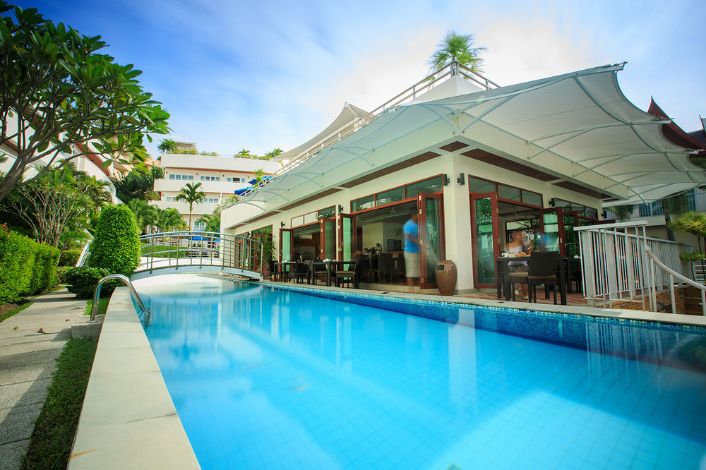 Phuket hotel for sale in karon beach thailand 4 star for Houses for sale with suites